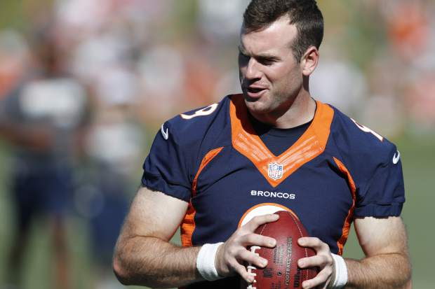 Denver Broncos quarterback Kevin Hogan looks to pass the ball during drills at the team's NFL football training camp Friday, July 19, 2019, in Englewood, Colo. (AP Photo/David Zalubowski)