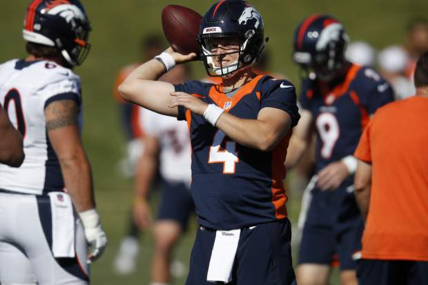 Denver Broncos quarterback Brett Rypien looks to pass the ball during drills at the team's NFL football training camp Friday, July 19, 2019, in Englewood, Colo. (AP Photo/David Zalubowski)