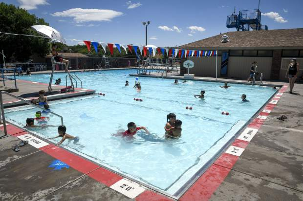 Children enjoy the cool waters of the Art Dague Pool and Waterslide in Rifle last weekend. RIfle Parks and Recreation unveiled the final images for the new pool and renovation of the 50-year-old facility.