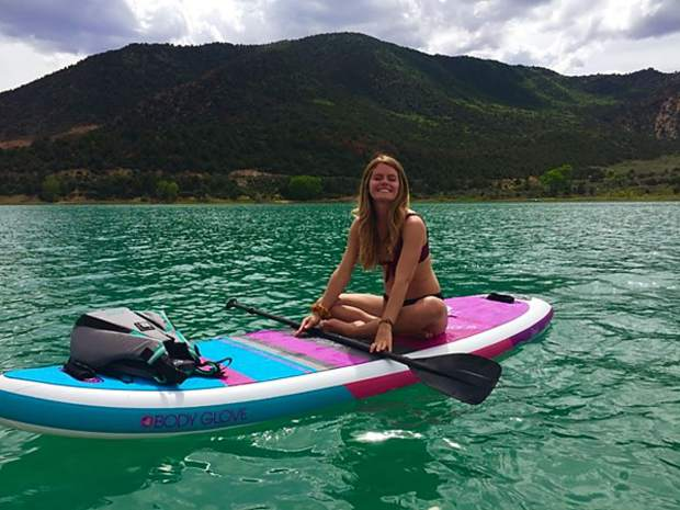 Paddle boarding on a sunny day at Harvey Gap in Silt, Colorado!