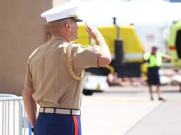 A military member awaits the arrival of Vice President Mike Pence at the Aspen/Pitkin County Airport on Monday, July 22, 2019. He came to Aspen for a fundraiser and was expected to depart on Tuesday. (Photo by Austin Colbert/The Aspen Times)