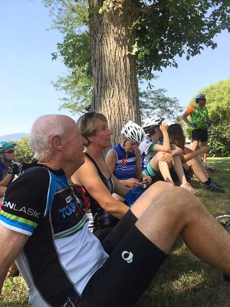 Cyclists take a break along the ride to listen to farm talk.