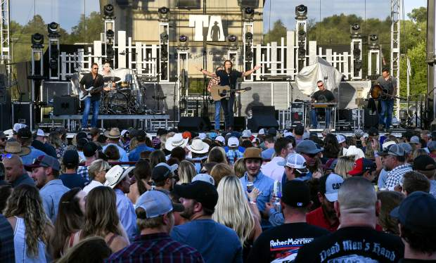 With the sun setting on the Garfield County Fairgrounds, a sea of people listen to Joe Nichols as he opens the Friday night concert.