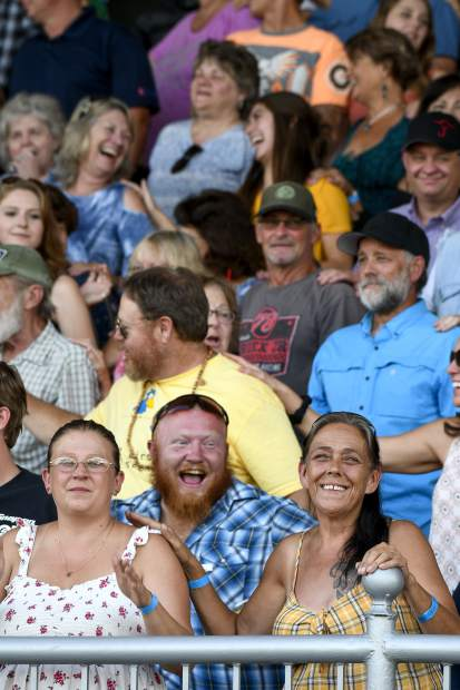 The crowd in the grandstand gets into the mood of the music as Joe Nichols urges concert goers to get to know their neihbor a little better.