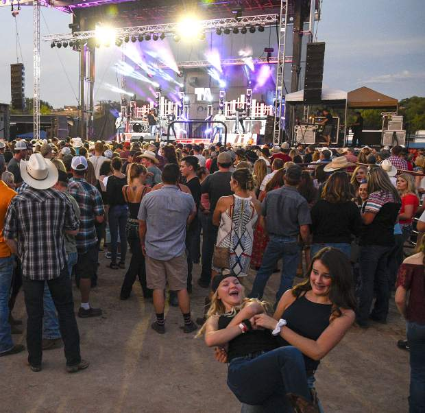 Garfield County Fair concert headliner Trace Adkins has the crowd dancing in the dirt during Friday night's concert.