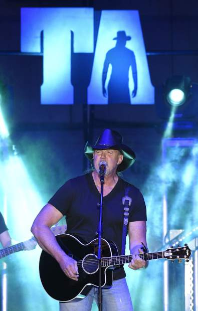 Country music star Trace Adkins sings a ballad to warm up the crowd Friday night in the Outdoor arena at the Garfield County Fair.