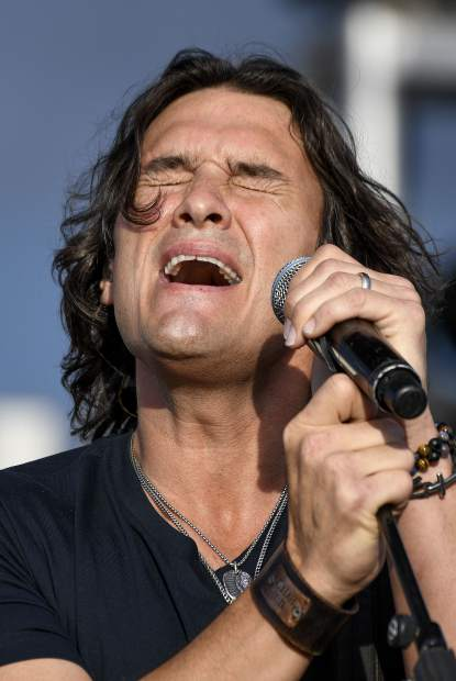 Joe Nichols belts out a tune as he performs at the Garfield County Fair Friday evening in Rifle.
