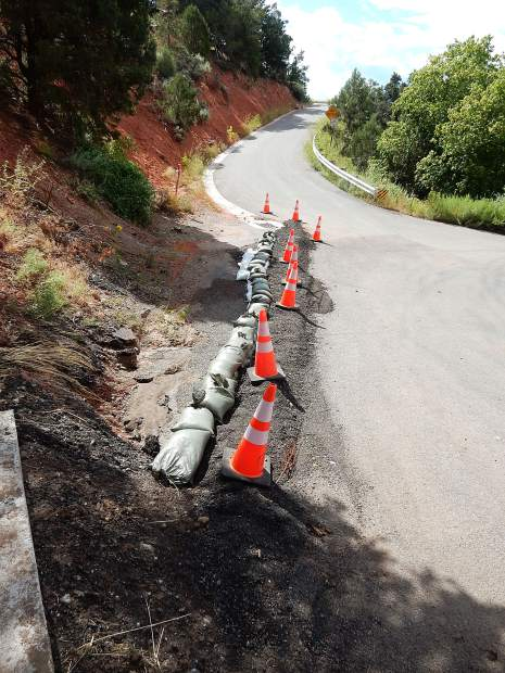 The Basalt town government added sandbags to try to channel water to a drainage hole if a flood overwhelms a culvert at Cedar Drive again.